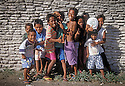 Marshall Islands, Micronesia: Majuro Atoll, Uliga community, Marshallese kids laughing and posing for photos.