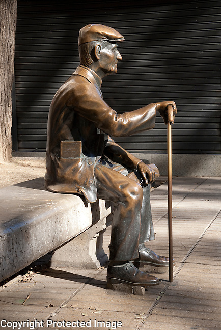 Statue of Old Man Reading Newspaper on the Ramblas, Tarragona, Catalonia, Spain