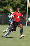04 October 2009: Maryland's Jasmyne Spencer (3) and Duke's Nicole Lipp (10). The University of Maryland Terrapins defeated the Duke University Blue Devils 4-0 at Koskinen Stadium in Durham, North Carolina in an NCAA Division I Women's college soccer game.