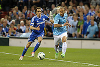 Yossi Benayoun (30) Chelsea and Pablo Zabaleta (5) Manchester City fight for the ball..Manchester City defeated Chelsea 4-3 in an international friendly at Busch Stadium, St Louis, Missouri.
