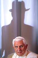 """Pope Benedict XVI, receives a gift from Israeli chief Rabbis Shlomo Amar, right, and Yona Metzger, left, at the center for the Jewish Heritage in Jerusalem, Tuesday, May 12, 2009. The pope told Israel's two chief rabbis that the Catholic Church is """"irrevocably committed"""" to """"a genuine and lasting reconciliation between Christians and Jews"""