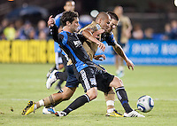 Fred (center) tries to dribbles through Joey Gjertsen (left) and Sam Cronin (right). The San Jose Earthquakes defeated the Philadelphia Unioin 1-0 at Buck Shaw Stadium in Santa Clara, California on September 15th, 2010.