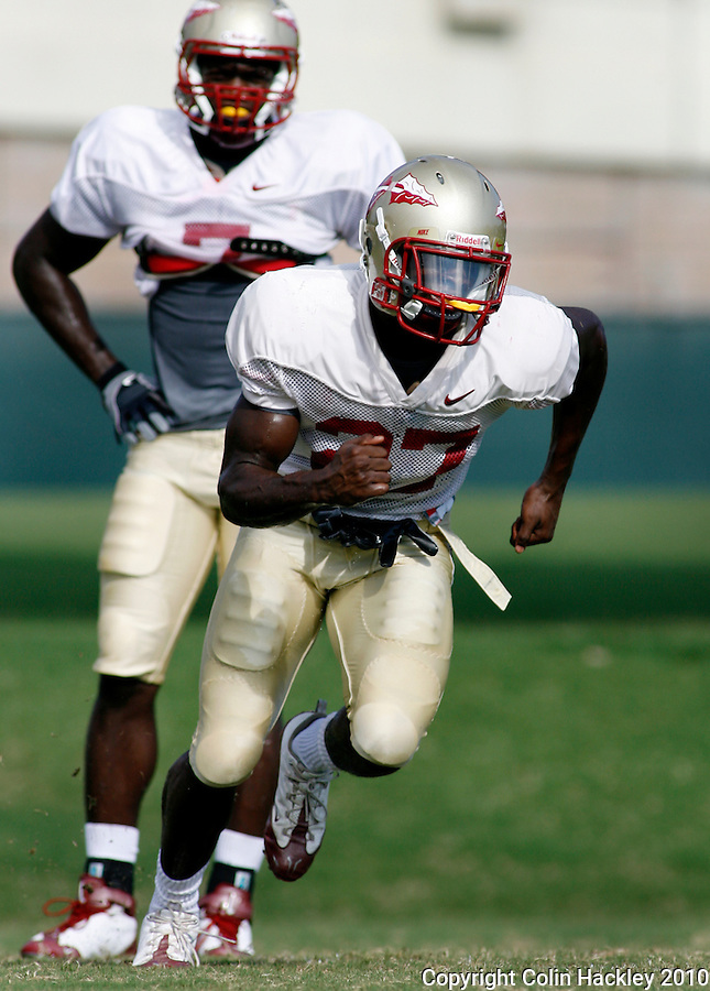 TALLAHASSEE, FL, 8/16/10-FSU-081610 CH-Florida State's Xavier Rhodes, right, runs a drill as Christian Jones watches during practice Monday in Tallahassee. .COLIN HACKLEY PHOTO