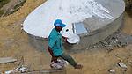 Comunidade de Jerusalém, município de Rubim na região do baixo Jequitinhonha, Norte de Minas Gerais. Nessa região é possível encontrar três tipos de biomas: caatinga, cerrado e mata atlântica. A ASA Brasil, Articulação no Semiárido Brasileiro, tem implementado em diversas comunidades no Norte de Minas o Programa Uma Terra e Duas Águas (P1+2) e o Programa Um Milhão de Cisternas (P1MC) que tem como objetivo viabilizar a captação e armazenamento de água de chuva nessas comunidades para consumo humano, criação de animais e produção de alimentos. Entre os parceiros para implementação dos projetos tem destaque na região a Cáritas Diocesana de Almenara.Mutirão para construção de calçadão, também conhecido como terreirão. Agenor Gomes de Souza.