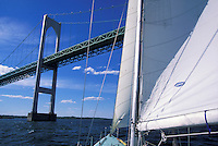 USA, Newport, RI - Sailing under Newport Bridge aboard 12 meter Nefertiti.