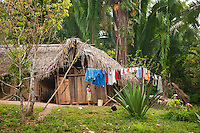 Santa Theresa, Moho River, Belize, April 2012. The native Maya people of the village of Santa Theresa still live a traditional lifestyle in their wooden thatch roofed homes without electricity. Santa Theresa is home to Pedro and Mario our Mayan river kayaking guides, and put in point for paddling the Moho river. The Moho river has many drop pools, waterfalls and rapids, but it also has quiet stretches. The river runs through the rainforest where we camp for the night. Photo by Frits Meyst/Adventure4ever.com