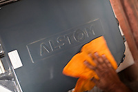 ALSTOM employees clean and move MJ81 - Intech Point Machines in the warehouse of ALSTOM's site project office near to the depot station Baiyappanahalli in Bangalore, Karnataka, India on 10th March 2011. .Photo by Suzanne Lee/Abaca Press
