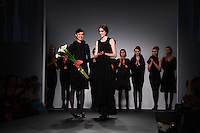 Models present designer Alexandra Groover with flowers at the Alexandra Groover fall 2009 collection at Vauxhall Fashion Scout during London Fashion Week on Friday, Feb. 20, 2009 in London, England. (Tina Gao/pressphotointl.com)