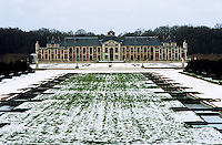 A view across the garden towards the spectacular facade of the 17th century Chateau du Champ de Bataille