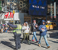 Football fans outside the H&M store on  Super Bowl Boulevard in Midtown Manhattan in New York on Thursday, January 30, 2014. Despite the game being held in New Jersey on February 2 sports fans are packing New York to take part in the multitude of activities planned around the game including the 13 block stretch of Broadway, running from 34th street through 47th street that will host Super Bowl Blvd. from January 29 to February 1. (© Richard B. Levine)