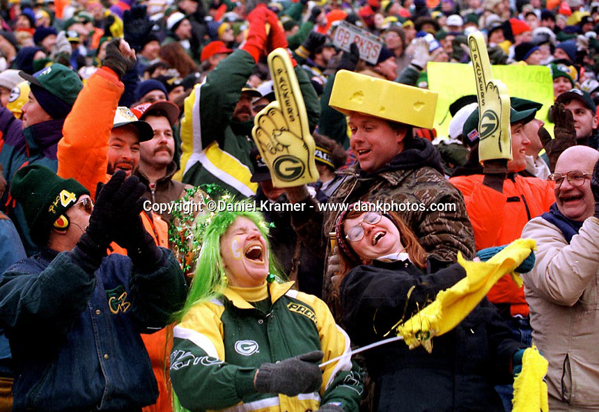 """Green Bay Packers fans celebrate a touchdown during the NFC Divisional Playoff Game against the 49ers on January 4, 1997. Dubbed the """"Mud Bowl"""", the Packers emerged the victor 35-14."""