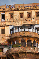 Traditional architecture ancient building fronting the famous Ghats by The Ganges River in Holy City of Varanasi, India