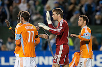 Tyler Deric (30) celebrates with his teammates after the game. The Houston Dynamo defeated the San Jose Earthquakes 1-0 at Buck Shaw Stadium in Santa Clara, California on October 16th, 2010.