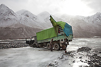 A truck bringing goods to the Wakhan corridor, got stuck in the ice on the Wakhan river..Drive from Kret village to Sarhad village, end of the road in the Wakhan Corridor.