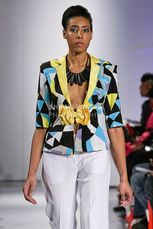 Model walks the runway in an outfit by Candice A. Williams from the Abeyo & Marqz Boutique Spring Summer collection, during BK Fashion Weekend Spring Summer 2012.