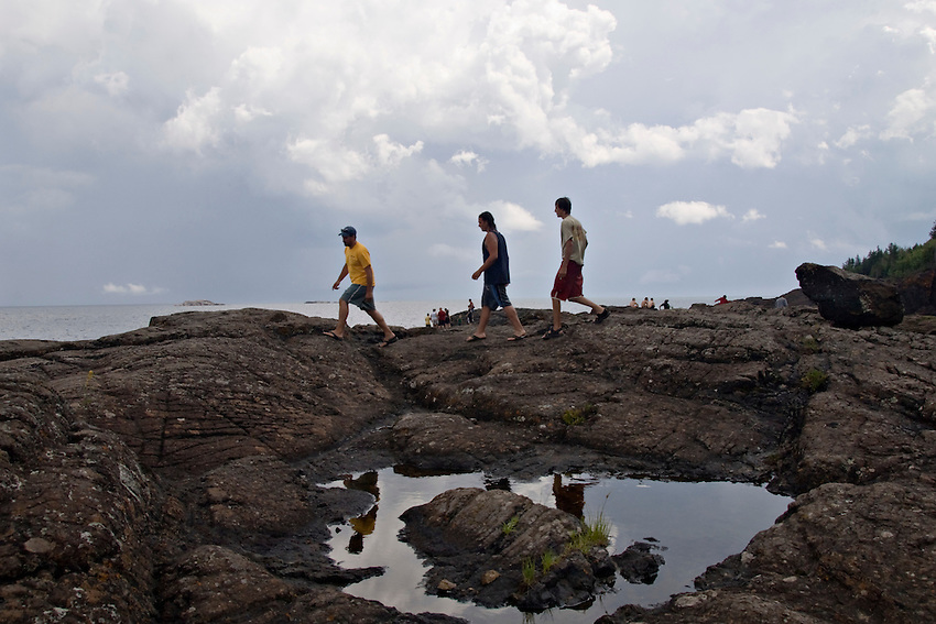 People explore the Black Rocks area of Presque Isle Park on Lake Superior in Marquette Michigan.