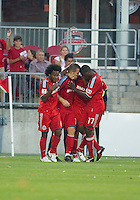 27 July 2010: Toronto FC players celebrate a goal by Toronto FC forward Chad Barrett #19 during a CONCACAF Preliminary game between Club Deportivo Motagua and Toronto FC at BMO Field in Toronto..Toronto FC won 1-0....