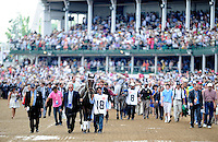 The field and connections walk to the paddock for the 138th Kentucky Derby at Churchill Downs in Louisville, Kentucky on May 5, 2012