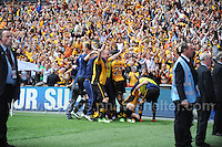 Newport County players celebrate winning promotion during the Newport County v Wrexham Blue Sq. Bet Premier league playoff final at Wembley Stadium, London, England Sunday 5th May 2013. Credit for pictures to Jeff Thomas Photography - www.jaypics.photoshelter.com - 07837 386244 - Use of images are restricted without prior permission of the copyright owner Jeff Thomas Photography.