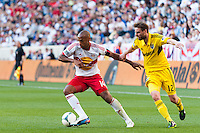 Thierry Henry (14) of the New York Red Bulls is marked by Eddie Gaven (12) of the Columbus Crew. The New York Red Bulls and the Columbus Crew played to a 2-2 tie during a Major League Soccer (MLS) match at Red Bull Arena in Harrison, NJ, on May 26, 2013.