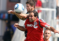 Stefani Miglioranzi #6 of the Philadelphia Union goes up for a header with Nick LaBrocca #21 of Toronto FC during an MLS match at PPL stadium in Chester, PA. on July 17 2010.Union won 2-1.