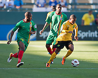 CARSON, CA – June 6, 2011: Jamaican Eric Vernan (8) moves past Greneda player Anthony Straker (15) during the match between Grenada and Jamaica at the Home Depot Center in Carson, California. Final score Jamaica 4 and Grenada 0.