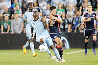 Julio Cesar (55) Sporting KC holds off Benny Feilhaber (22) New England... Sporting Kansas City defeated New England Revolution 3-0 at LIVESTRONG Sporting Park, Kansas City, Kansas.