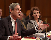Washington, D.C. - April 14, 2004 --  Robert S. Mueller, III, Director, Federal Bureau of Investigation (FBI), testifies before the National Commission on Terrorist Attacks (9-11 Commission) in Washington, DC on April 14, 2004.  Maureen Baginski, Executive Assistant Director for Intelligence, Federal Bureau of Investigation (FBI) looks on from right.<br /> Credit: Ron Sachs / CNP<br /> [RESTRICTION: No New York Metro or other Newspapers within a 75 mile radius of New York City]