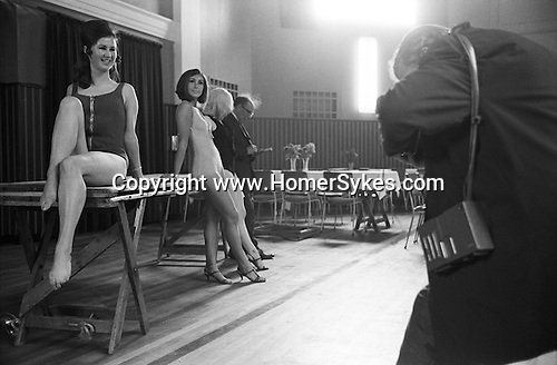 Blackpool summer season beauty competition contestant being photographed. Lancashire England 1970