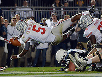 Ohio State Buckeyes quarterback Braxton Miller (5) dives over the Penn State Nittany Lions defense for his first touchdown of his NCAA football game at Beaver Stadium, in University Park, Pa., October 27, 2012.   (Dispatch photo by Neal C. Lauron)