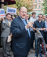 Republican Mayoral candidate Joe Lhota speaks to the press after visiting small businesses and campaigning on the 37th Avenue business district in the Jackson Heights neighborhood of Queens in New York on Friday, September 27, 2013.  Jackson Heights is a polyglot of ethnic groups ranging from Bangladeshis to South American to Indian to everyone else. (© Richard B. Levine)