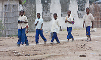 Jambiani, Zanzibar, Tanzania.  Muslim Schoolboys Walking to School.