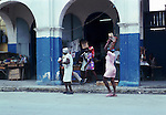Taking home the shopping.  Images of the capital,Port au Prince, Haiti 1975