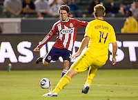 Chivas USA midfielder Blair Gavin (18) moves with the ball and looks beyond Columbus Crew defender Chad Marshall (14). CD Chivas USA defeated the Columbus Crew 3-1 at Home Depot Center stadium in Carson, California on Saturday July 31, 2010.