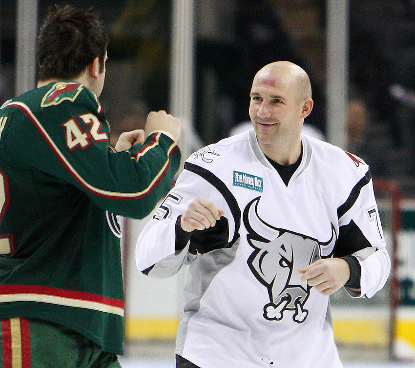 AMERICAN HOCKEY LEAGUE -- San Antonio's Peter Vandermeer (75) squares off against Houston's Matt Kassian (42) during the game between the Houston Aeros and the San Antonio Rampage, March 23, 2008, at the AT&T Center in San Antonio. Houston won 3 - 2. (Darren Abate/PressPhotoIntl.com)
