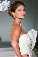 Model walks the runway in a Beth Elis Daybreak wedding dress by Nere Emiko during the Wedding Trendspot Spring 2011 Press Fashion, October 17, 2010.