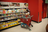A shopper at the children's book department in the new Target store in the East Harlem neighborhood of New York on its opening day, Sunday, July 25, 2010. Target, which is the second largest discount retailer in the United States has opened its first permanent Manhattan location in the East River Plaza, a vertical mall. The company has projected revenue of $90 million in the stores first year of operation (© Richard B. Levine).