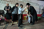 Ultra-Orthodox Jews perform a 'Kaparot' ceremony, in the ultra-orthodox Jewish city of Bnei Brak, near Tel Aviv, Israel. The participants in the Jewish ritual believe they transfer their past year's sins to the chicken, and perform it before the Day of Atonement ('Yom Kippur'), the holiest day in the Jewish calendar.