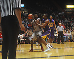 "Ole Miss forward Terrance Henry (1) fouled by Louisiana State's Storm Warren (24) at the C.M. ""Tad"" Smith Coliseum in Oxford, Miss. on Wednesday, February 9, 2011. Ole Miss won 66-60 and is now 4-5 in the Southeastern Conference."