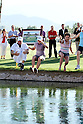 "Stacy Lewis (USA), APRIL 3, 2011 - Golf : Stacy Lewis of USA (C) jumps into Champions Lake ""Poppie's Pond"" with her caddie Travis Wilson (L) and her sister Janet (R) after winning the Kraft Nabisco Championship at Mission Hills Country Club in Rancho Mirage, California, USA. (Photo by Yasuhiro JJ Tanabe/AFLO)"