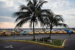 HAVANA, CUBA -- MARCH 24, 2015:   Taxi drivers wait for customers outside of the Meliá Cohiba hotel in Vedado neighborhood of Havana, Cuba on March 24, 2015. Photograph by Michael Nagle