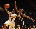 "Mississippi's Valencia McFarland (3) shoots and scores as Central Michigan's Jessica Green (3) defends at C.M. ""Tad"" Smith Coliseum in Oxford, Miss. on Wednesday, December 14, 2011. (AP Photo/Oxford Eagle, Bruce Newman)"