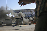 Palestinian protester shoot a fireworks during clalshes with Israel Defense Forces after the funeral held for three Palestinians killed during IDF operation at Kalandia refugee camp on August 26, 2013 in Ramallah, West Bank. Photo by Oren Nahshon