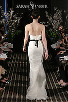 Model walks runway in a Cherish wedding dress by Sarah Jassir, for the Sarah Jassir Fall 2011 - Desire bridal collection.
