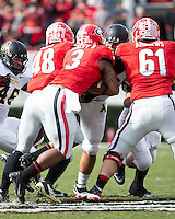 The Georgia Bulldogs beat the App State Mountaineers 45-6 in their homecoming game.  After a close first half, UGA scored 31 unanswered points in the second half.  Georgia Bulldogs running back Todd Gurley (3), Georgia Bulldogs center David Andrews (61), Georgia Bulldogs fullback Quayvon Hicks (48)