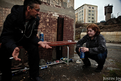 Sergei and Masha, a 19-year-old mother, drink beer during polar midnight in spring in the nickel-producing town of Zapolyarna. Here the fortune of the population is declining with the collapse of heavy industry in the Arctic north.