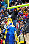 28 December 2008: After high winds during the game, Buffalo Bills field technicians adjust the goalposts in the third quarter during a game against the New England Patriots at Ralph Wilson Stadium in Orchard Park, NY. The Patriots kept their playoff hopes alive defeating the Bills 13-0 in their 16th win against Buffalo of their past 17 meetings. ***** Editorial Use Only ******..Mandatory Photo Credit: Ed Wolfstein Photo