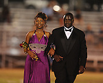 Keyona Peery (left) is escorted by Jamal Buford during Lafayette High vs. Byhalia in homecoming football action in Oxford, Miss. on Friday, September 24, 2010.