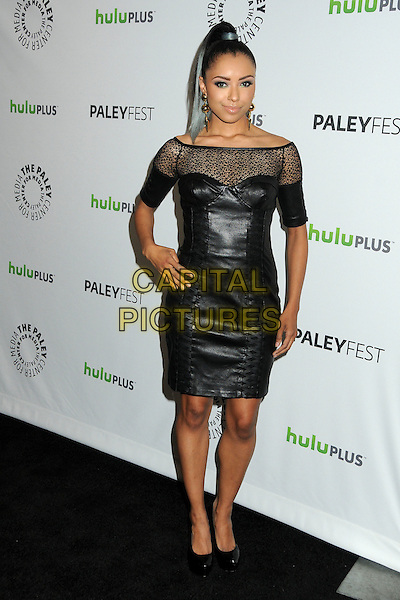 """Kat Graham.PaleyFest 2012 Presents """"The Vampire Diaries"""" held at the Saban Theatre. Beverly Hills, California, USA, .10th March 2012.full length off the shoulder sheer leather dress  black  corset bustier hand on hip .CAP/ADM/BP.©Byron Purvis/AdMedia/Capital Pictures."""