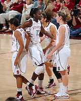 STANFORD, CA - January 27, 2013: Stanford Cardinal's Chiney Ogwumike congratulates Toni Kokenis clinching 3-pt play during Stanford's 69-56 victory over the Colorado Buffaloes at Maples Pavilion in Stanford, California.